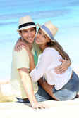 Couple sitting by the beach — Stock Photo