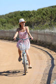 Girl with summer dress on bicycle — Stock Photo