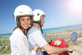 Girl riding moto with boyfriend — Stock Photo