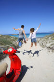 Couple running and jumping to beach — Foto Stock
