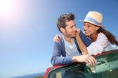 Couple in convertible car — Stock Photo