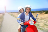 Couple riding moto — ストック写真