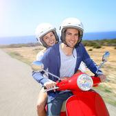 Couple on motorcycle on island — Stock Photo