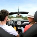 ������, ������: Couple driving convertible car