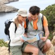 Hikers reading map — Stock Photo