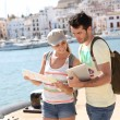 Tourists looking at city map — Stock Photo #47817523