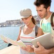Tourists looking at city map — Stock Photo #47817533