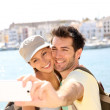 Couple taking picture of themselves — Stock Photo #47817609