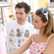 Woman with boyfriend doing shopping — Stock Photo #47817867