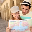 Couple with map — Stock Photo #47818271