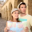 Couple with map — Stock Photo #47818273