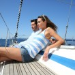 Couple relaxing on sailboat — Stock Photo