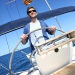 Skipper on sailboat — Stock Photo #47818487