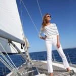 Woman posing on sailboat — Stock Photo #47818791