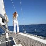 Woman on sailboat deck — Stock Photo #47818803