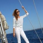 Woman on sailboat deck — Stock Photo #47818805