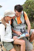 Hikers reading orientation map — Stock Photo