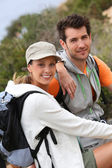 Young couple on hiking journey — Stock Photo