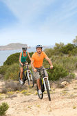 Couple riding on island trail — Stock Photo