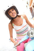 Woman riding motorcycle — Stock Photo