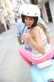 Girl on moto showing thumb up — Stock Photo