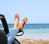 Feet by car window — Stock Photo