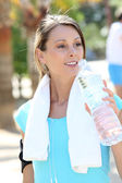 Fitness girl drinking water — Stock Photo