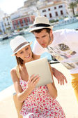 Tourists websurfing with tablet — Stock Photo