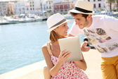 Tourists websurfing — Stock Photo