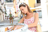 Woman shopping in tourist area — Stock Photo