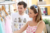 Woman with boyfriend doing shopping — Stock Photo