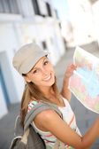 Girl holding map — Stock Photo