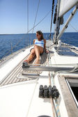 Woman relaxing on sailboat — Stock Photo