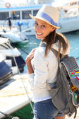 Girl getting on boat — Stock Photo