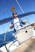 Skipper on sailboat — Stock Photo