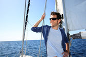 Skipper standing on sailboat — Stock Photo
