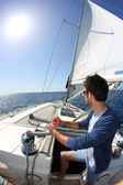 Man sailing with sails out — Stock Photo