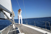 Woman on sailboat deck — Stock Photo