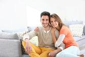 Couple on sofa — Stock Photo