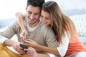 Couple with smartphones — Stock Photo