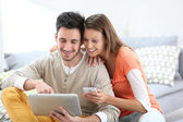 People connected on tablet — Stock Photo