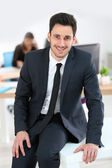 Businessman on table — Stock Photo