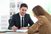 Woman meeting financial adviser — Stock Photo