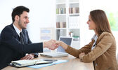 Woman giving handshake to adviser — Stock Photo