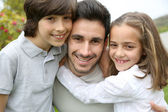 Man with kids — Stock Photo