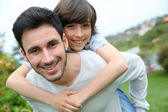 Father giving piggyback ride — Stock Photo