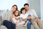 Family sitting together — Stock Photo