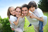 Happy family outside — Stock Photo