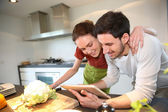 Couple looking for recipe — Stock Photo