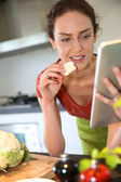 Woman looking at recipe on tablet — Stock Photo